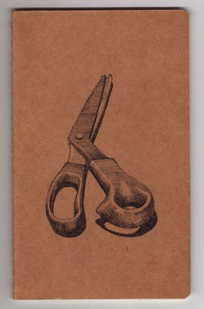 Scissors on Moleskine journal