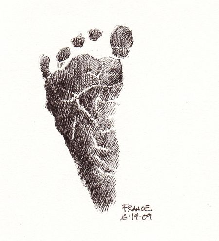 Nora's footprint with pen